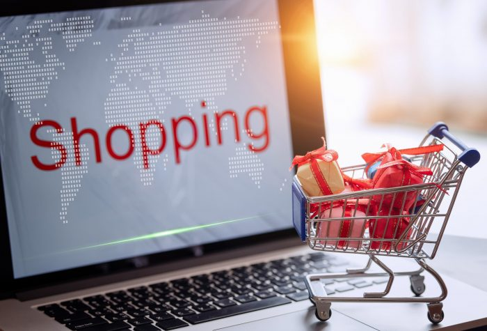 Boxes in shopping cart on table,online shopping,delivery on the world,Technologies connecting the world.